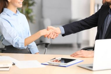 Manager and client shaking hands