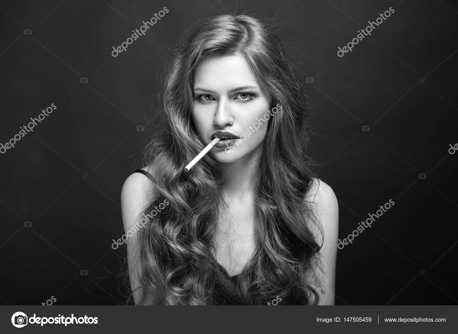 https://st3.depositphotos.com/1177973/14750/i/1600/depositphotos_147505459-stock-photo-beautiful-woman-with-cigarette.jpg
