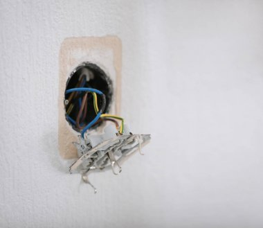 socket hanging out of wall