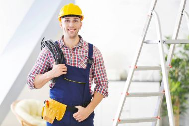 electrician standing near stepladder