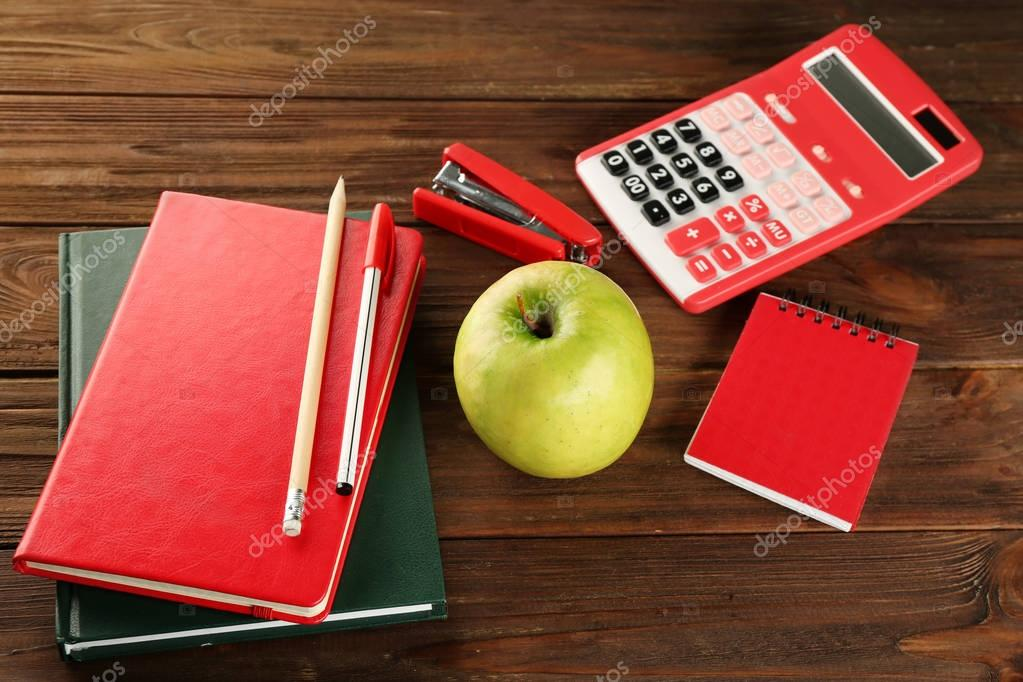 Appetizing green apple and stationery