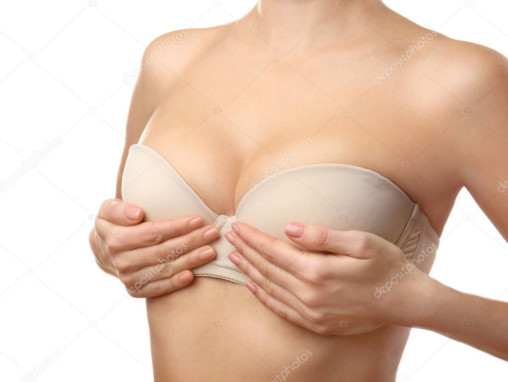 Young woman in beige bra