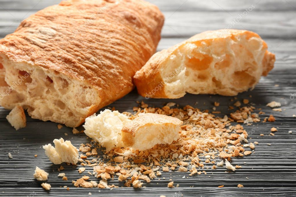 Bread and crumbs on wooden table