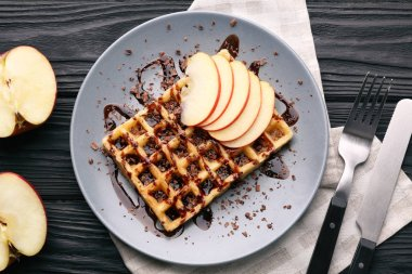 Delicious waffles with apple slices