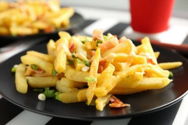 french fries with bacon and onion