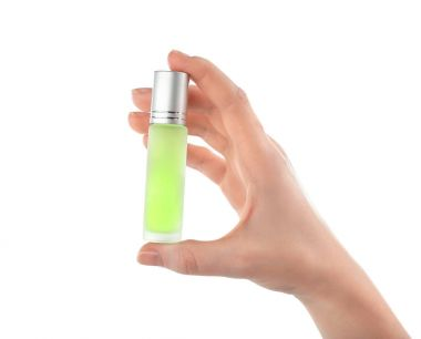 hand holding bottle with perfume