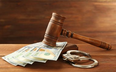 Judge's gavel, handcuffs and money