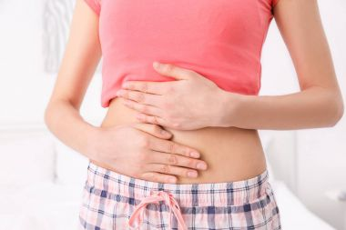 woman with hands on her belly