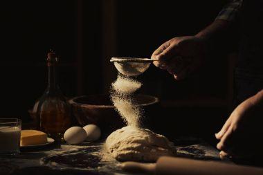 Man making dough in kitchen