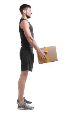 Man lifting heavy cardboard box