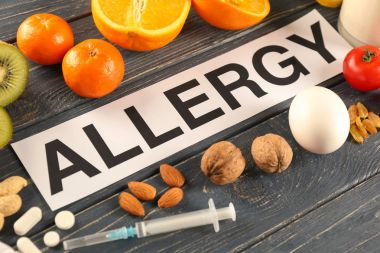 Word ALLERGY, food and syringe