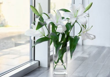 Vase with beautiful white lilies on windowsill stock vector