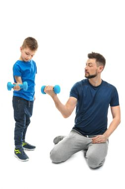 Father and son with dumbbells