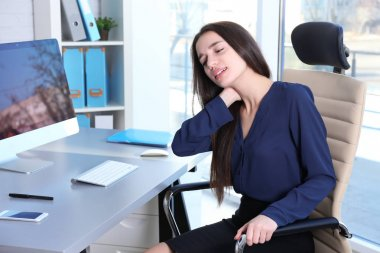 Young woman suffering from neck pain