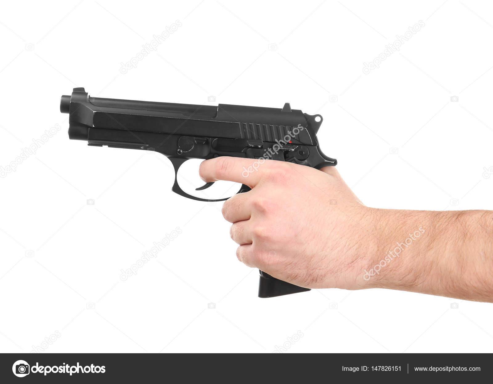 Man's hand holding gun — Stock Photo © belchonock #147826151