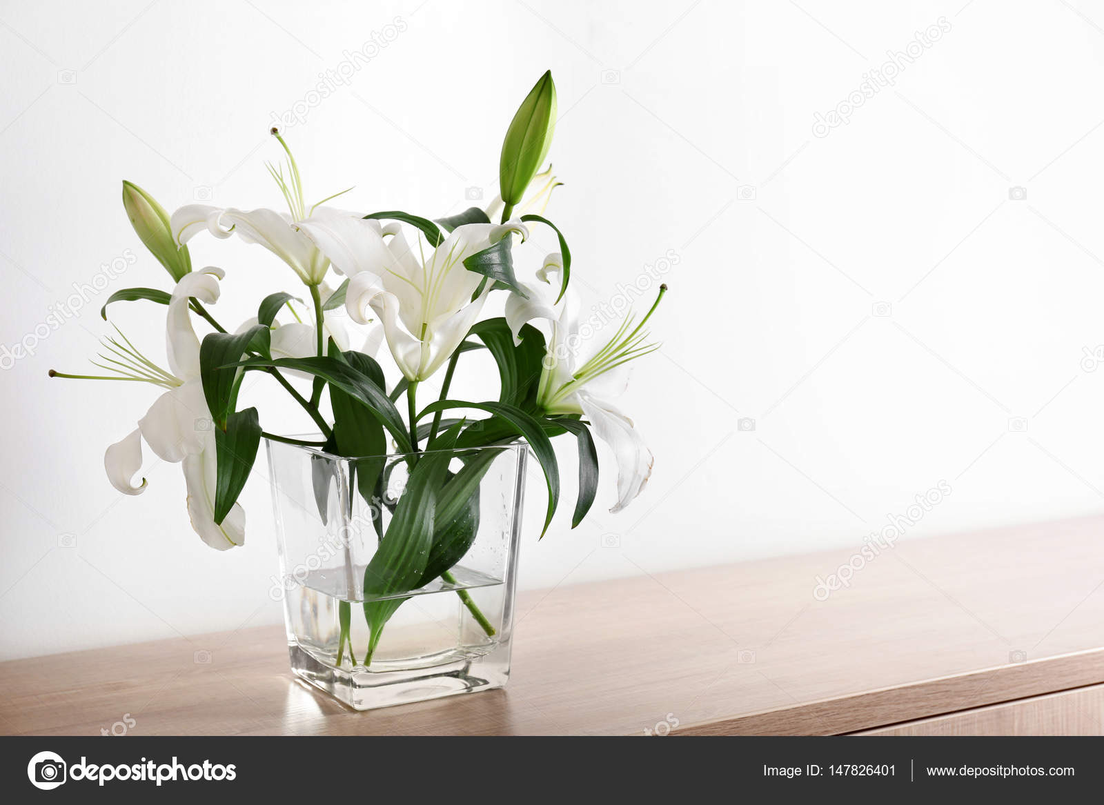 Beautiful white lilies in vase stock photo belchonock 147826401 beautiful white lilies in vase on table photo by belchonock reviewsmspy