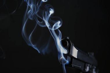 Smoking gun on black