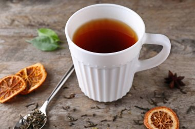 Cup of aromatic tea with dried lemon slices