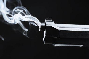 Smoking gun on black
