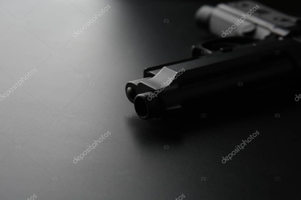 Gun on black background stock vector