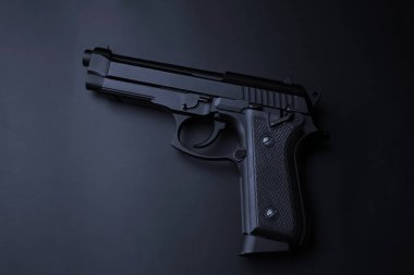 Gun on black background