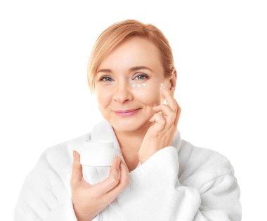Senior woman applying anti-aging cream