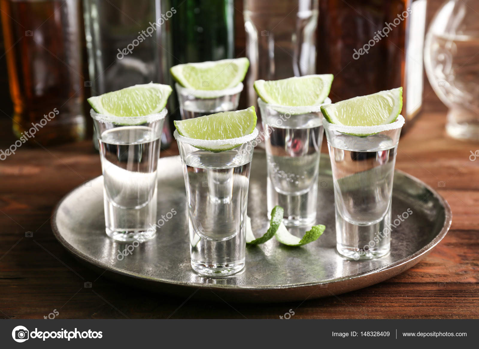 Tequila shots with juicy lime slices and salt on tray — Stock ...