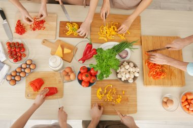 People cutting vegetables