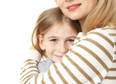 Cute girl with her mother on white background, closeup