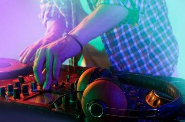 DJ mixing tracks on mixer