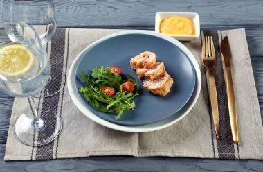 Portion of delicious chicken cordon bleu on plate