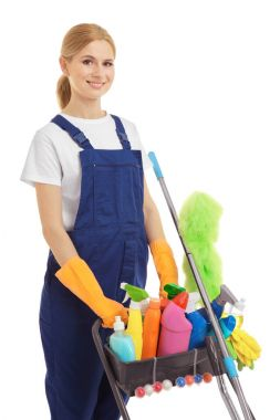 Woman with cleaning agents and supplies on white background