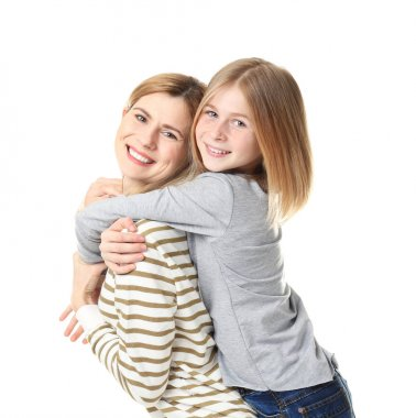 Happy mother and daughter on white background
