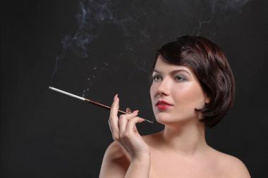 woman smoking with cigarette holder