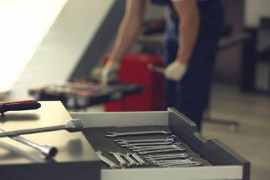 Drawer unit with tools in car repair
