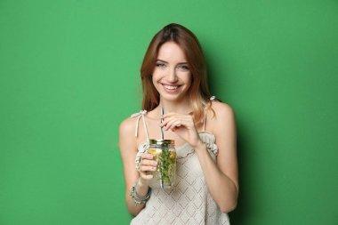 Beautiful young woman with lemonade