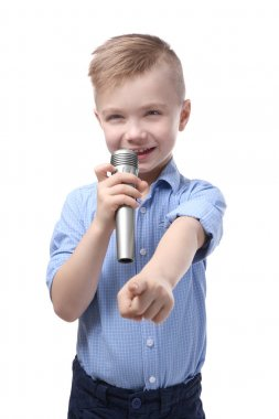 Cute little boy with microphone