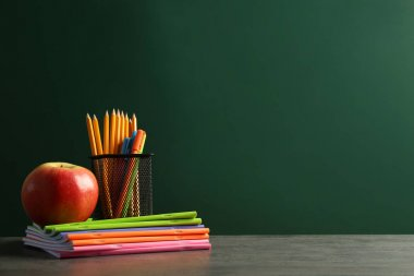 Stationery and apple on notebooks