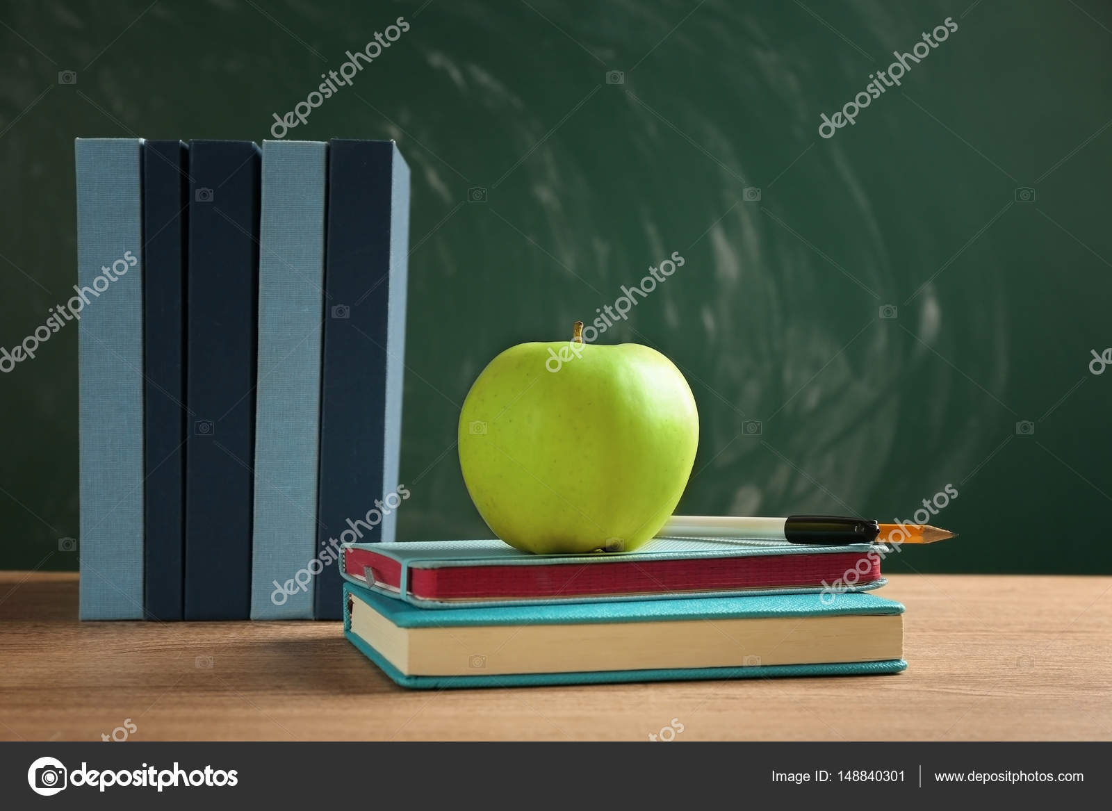 Books And Apple On Chalkboard Background Photo By Belchonock