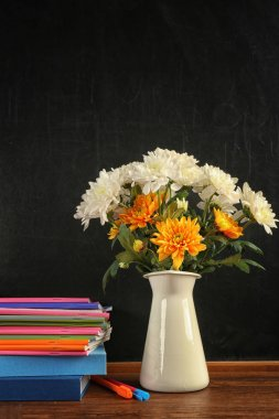 Bouquet of flowers with copybooks