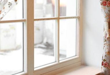 Large wooden window with curtains