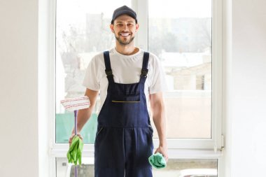 young male window cleaner in uniform