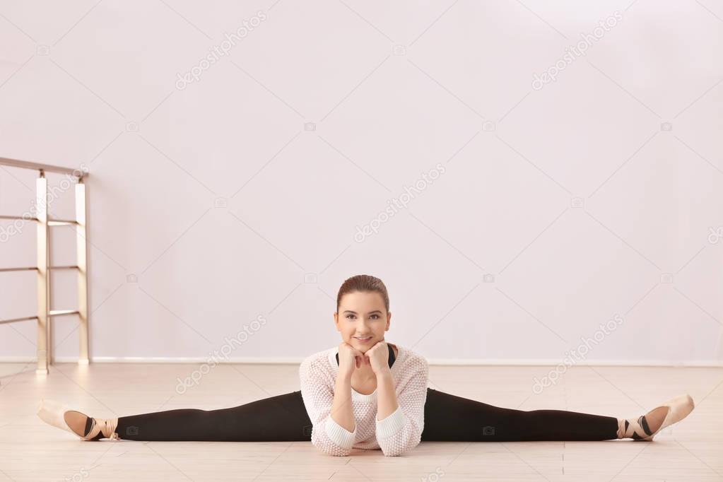 Young beautiful ballerina training