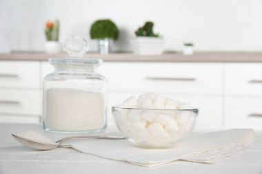 Glass bowl with sugar cubes
