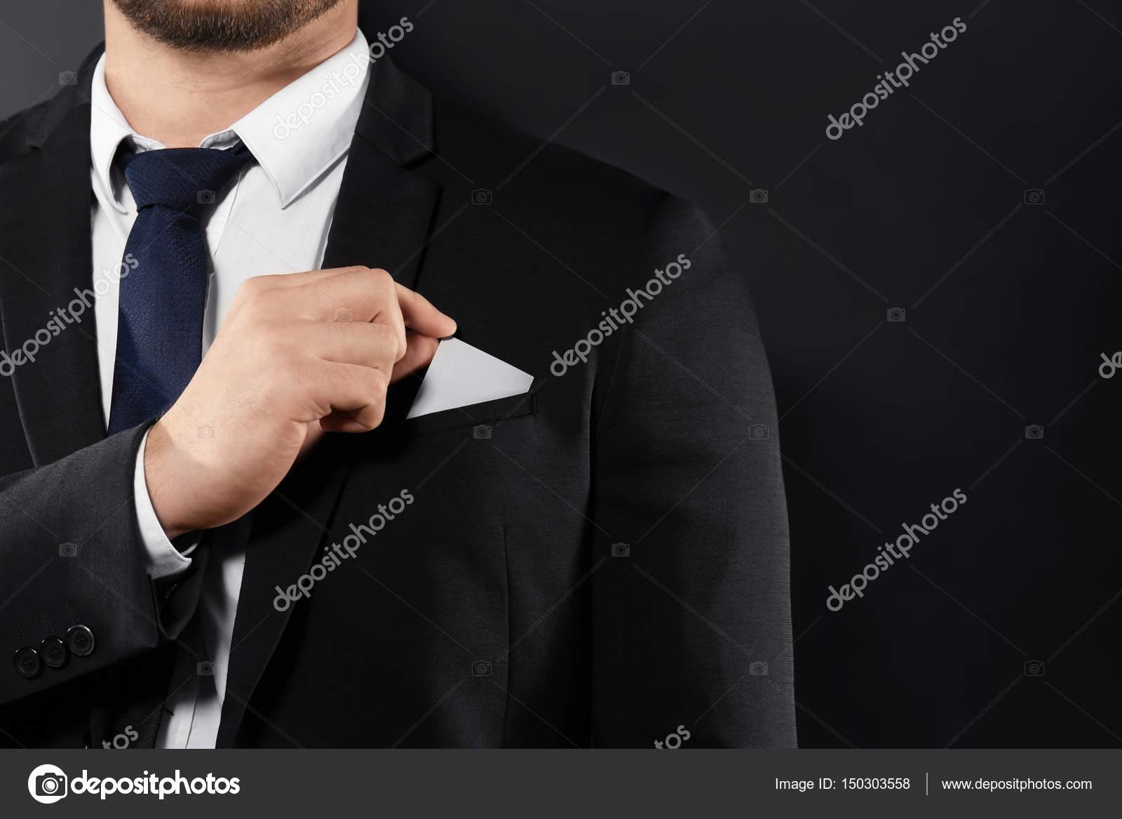 Man putting business card into pocket — Stock Photo © belchonock ...