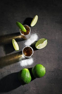 Tequila shots with lime slices