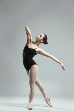 Young beautiful ballerina dancing