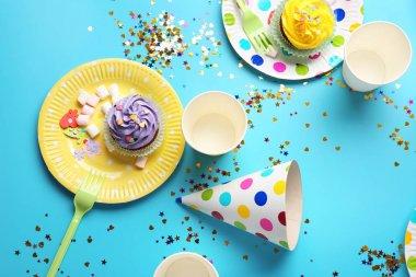 Plates with birthday cupcakes