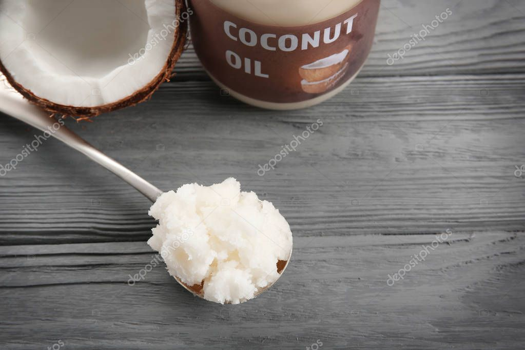 spoon with fresh coconut oil