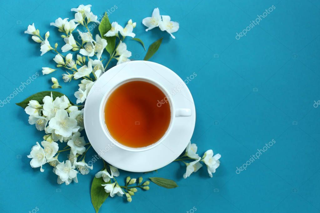Cup of tea with jasmine flowers